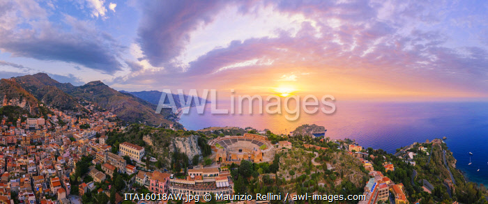 Taormina, Sicily. Aerial view of the Greek theater with the sun rising on the sea in the background