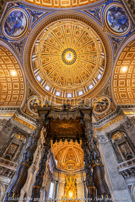Low angle interior view of the baldacchino and main dome, St. Peter's Basilica, Vatican City