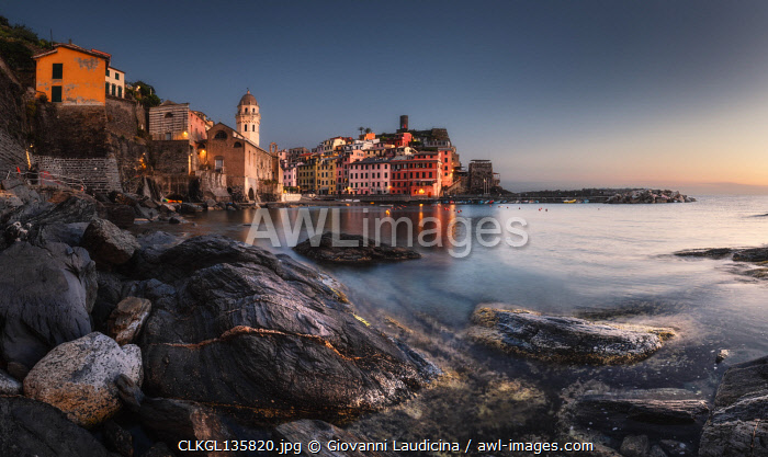 awl-images.com - Italy / A panoramic view in the evening on Vernazza, National Park of Cinque Terre, municipality of Vernazza, La Spezia province, Liguria district, Italy