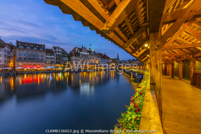 awl-images.com - Switzerland / Kapellbr��cke and city illuminated at dusk, Luzern, Canton Luzern, Switzerland