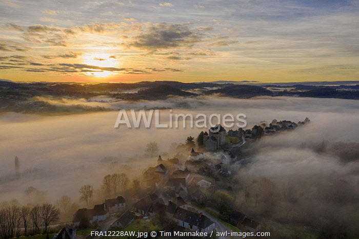 awl-images.com - France / France, Nouvelle-Aquitaine, Correze, Curemonte, aerial view of Curemonte village on a misty morning