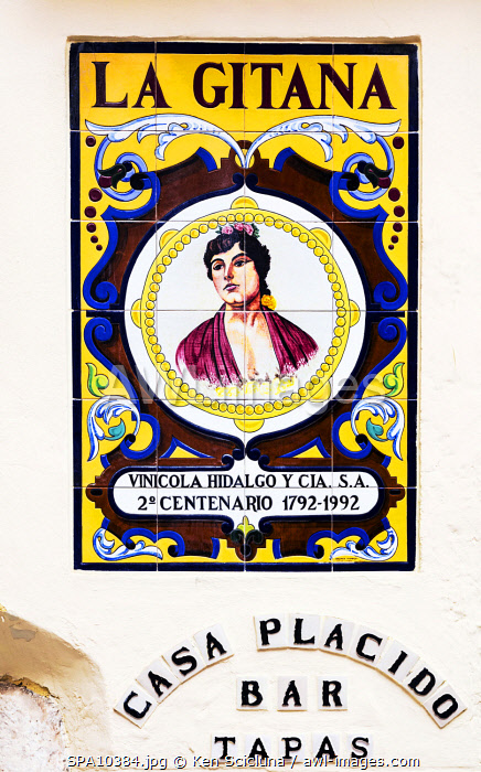 awl-images.com - Spain / Spain. Andalusia. Seville. Painted sign on tiles advertising La Gitana a brand which produces Andalusian fortfied wine Sherry.