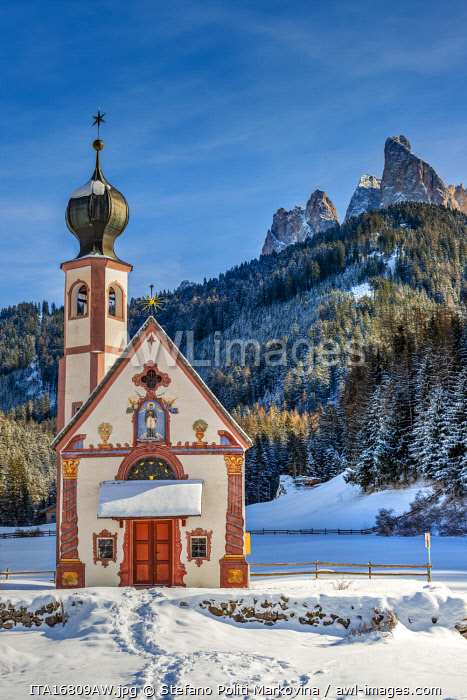 awl-images.com - Italy / Scenic winter view over St Johann in Ranui church with Odle Dolomites behind, Val di Funes, Alto Adige - South Tyrol, Italy