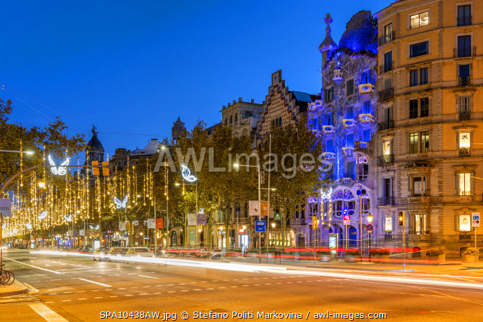 awl-images.com - Spain / Passeig de Gracia avenue adorned with Christmas lights and Casa Battlo, Barcelona, Catalonia, Spain