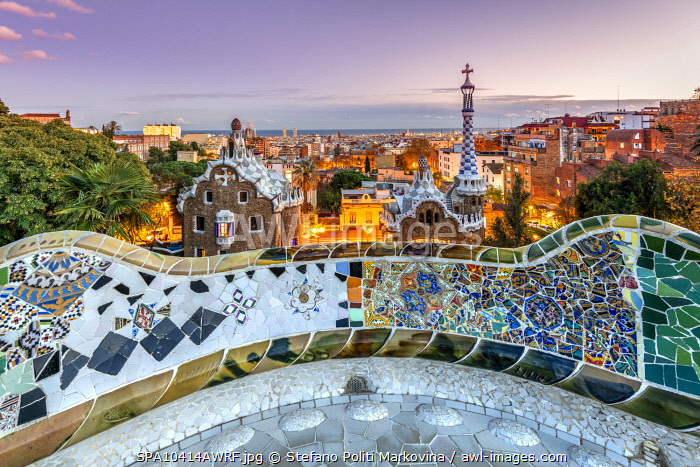 awl-images.com - Spain / Park Guell and city skyline at dusk, Barcelona, Catalonia, Spain