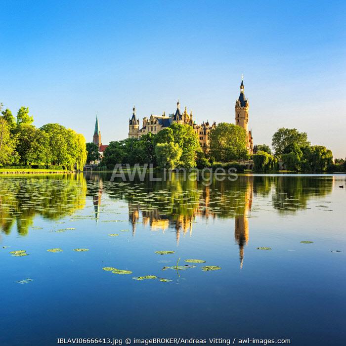 awl-images.com - Germany / Schwerin Castle at Schwerin Lake, water reflection with water lilies, Schwerin Cathedral on the left, Schwerin, Mecklenburg-Western Pomerania, Germany, Europe