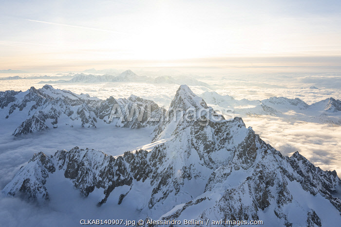 awl-images.com - Italy / Aerial view of snowy peaks of Mont Blanc and Dent du Geant during sunrise, Courmayeur, Aosta Valley, Italy, Europe