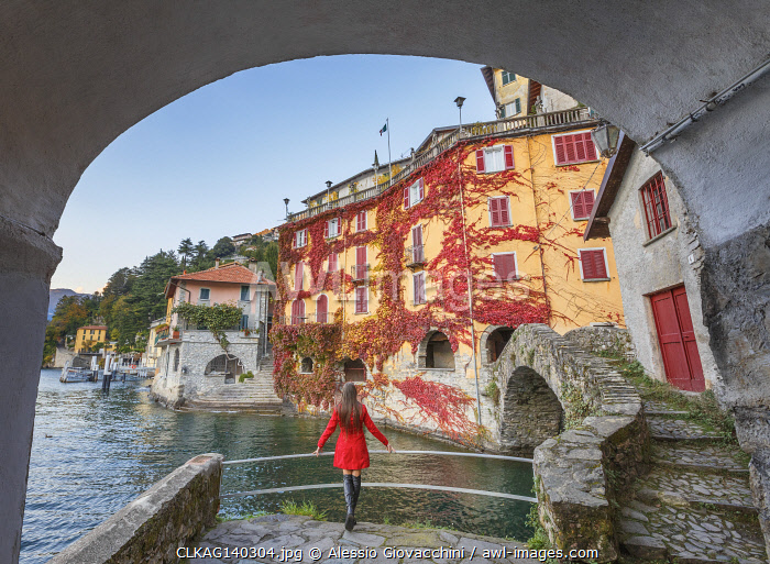 awl-images.com - Italy / A tourist looks lake Como from Nesso village in the Autumn, Como province, Lombardy, Italy, Europe (MR)