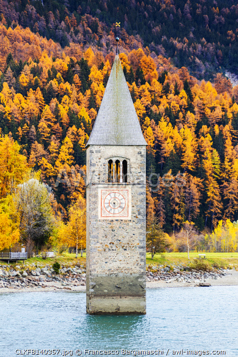 awl-images.com - Italy / Submerged tower of Curon Venosta in autumn. Curon Venosta, South Tirol, Italy.