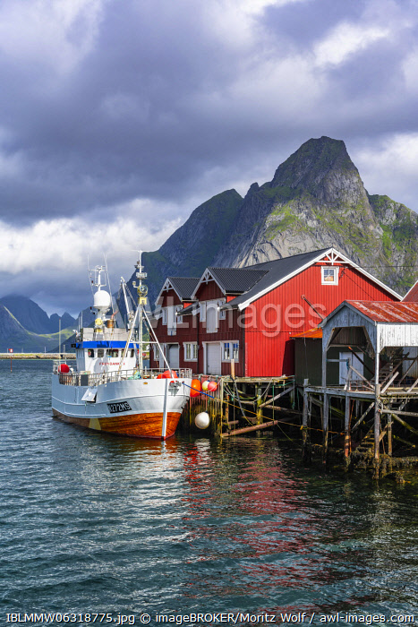 awl-images.com - Norway / Rorbuer, typical wooden houses, fishing boat in harbour, Reine, Moskenes�y, Lofoten, Nordland, Norway, Europe