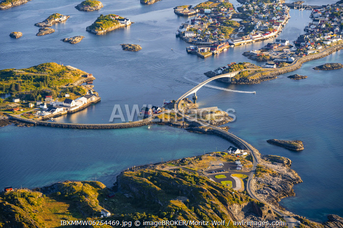 awl-images.com - Norway / Houses on small rocky islands in the sea, village view of Henningsv�r, V�gan, Lofoten, Nordland, Norway, Europe