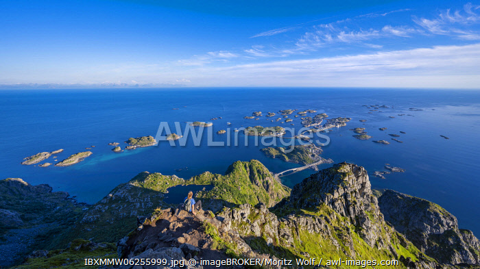 awl-images.com - Norway / Small rocky islands in the sea, hiker looks from the top of the mountain Festv�gtind to OrtHenningsv�r, V�gan, Lofoten, Nordland, Norway, Europe